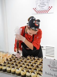 Three Brothers Bakery preparing the winning s'mores cupcakes at the Camp for All Culinary Challenge November 2013