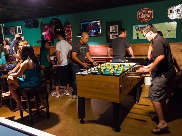 Guys playing game at Bryan Street Tavern in Dallas