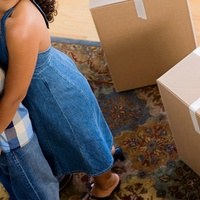 young couple moving into a new house with boxes no faces