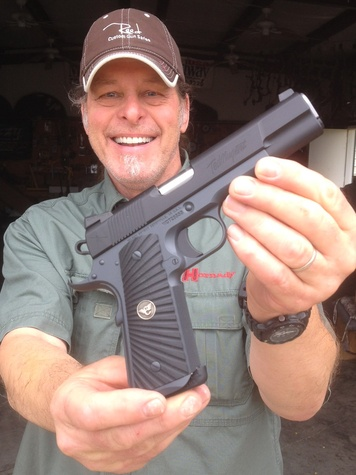 Ted Nugent with Wilson combat pistol