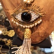 Gypsy jewelry designer Jeanette Simon with evil eye necklace