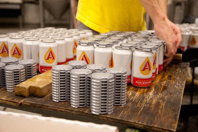 Austin Photo Set: News_Joelle_Austin Beerworks_feb 2012_canning_adding tops