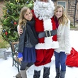9 Megan Balisdell, from left, Santa and Hallie Walton at Mission of Yahweh's gift-giving celebration December 2013.