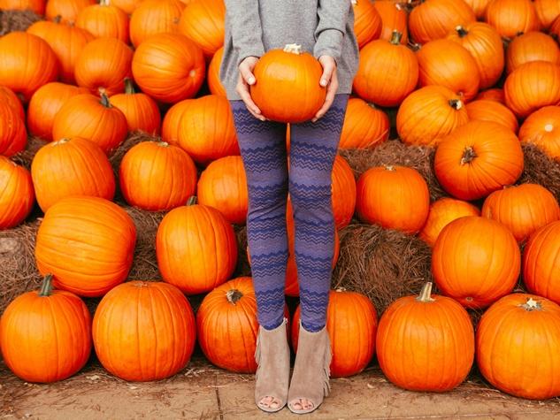 Women standing in a pumpkin patch