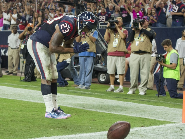 23 Texans vs. Colts October 2014 Arian Foster touchdown prayer bow