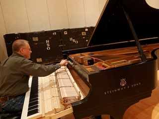 8 Kirill Gerstein prepares piano for Houston Symphony performance September 2013