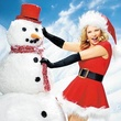 Kim Cattrall as sexy Santa with Snowman