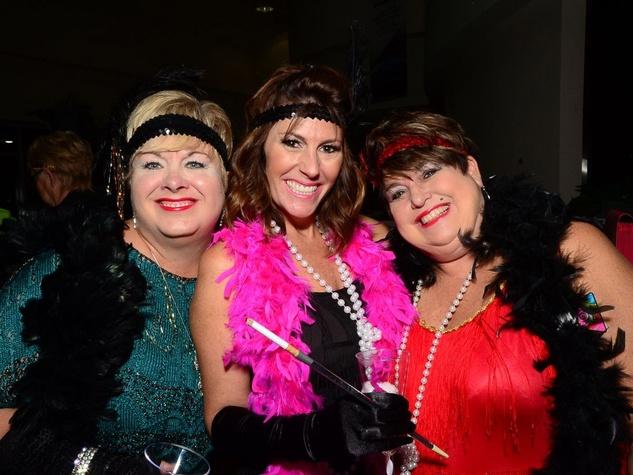 22 Christi Borden, left, Linda Burnett and Julie Lower at the Fellas and Flappers Sunshine Kids event October 2013