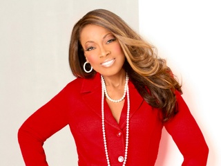 Star Jones in red top with pearls