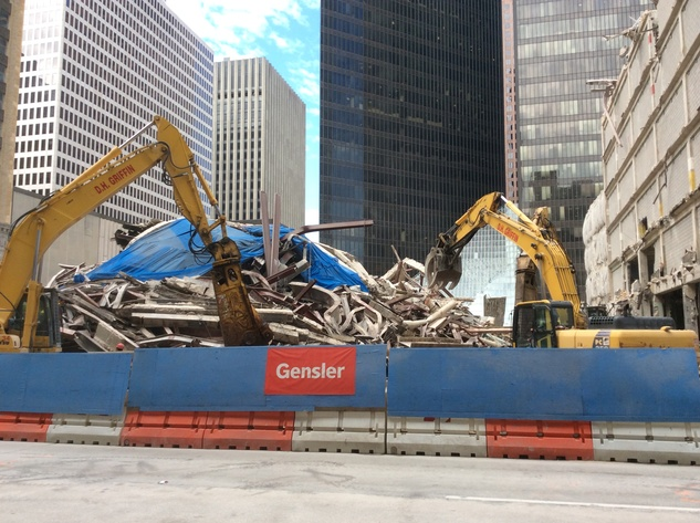 Debris is cleared from Houston Club implosion site. A 35-story office tower will be built there by Skanska October 2014