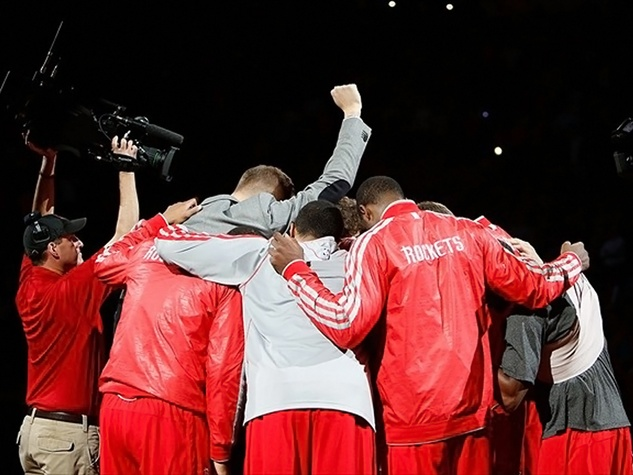 Houston Rockets basketball players in huddle