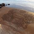 Sand art on beach