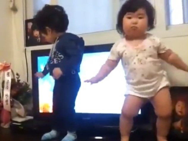 Chubby baby dances