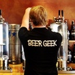 """growlers, beer, April 2013, A """"beer geek"""" and tap consultant fills a growler"""