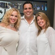 18 Jenee and Nick Stefanakis, from left, with Lori Shellist at the Texans White Party September 2014