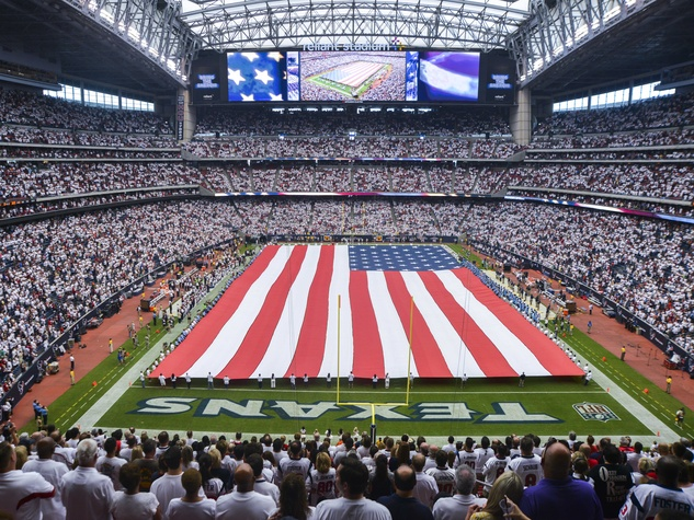 6 Texans owner's suite home opening game September 2013 American flag on football field at Reliant Stadium
