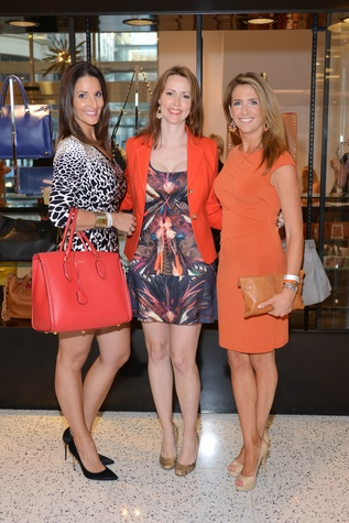 45 Ivana Rouse, from left, Rachel Walton and Carrie Carson at the WOW Summer Soiree August 2014