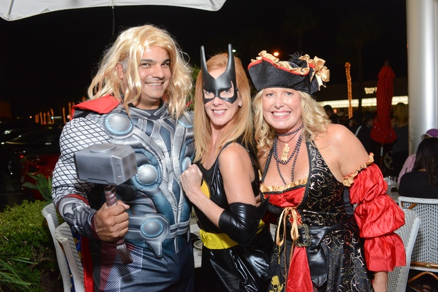 Armando Wood, from left, Michelle Toro and Christie Connell at the Brasserie 19 Halloween party October 2014