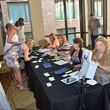 4th Annual Pay it Forward Benefit with Daniel Curtis in Austin Volunteers at registration table
