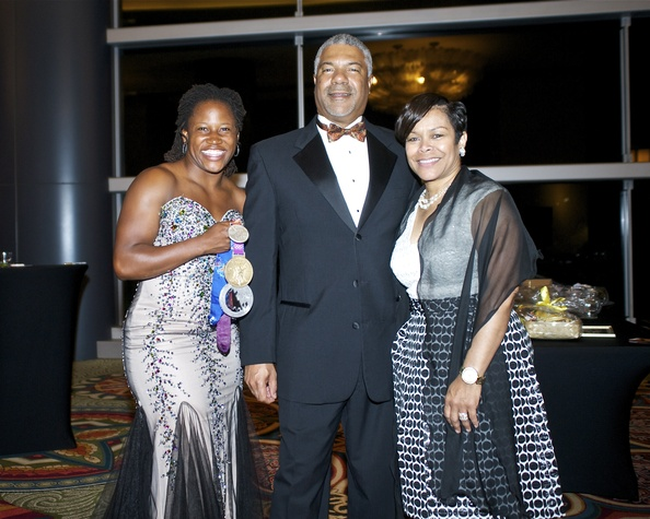0312 Lauryn Williams, from left, with Judson and Cora Robinson at the Houston Area Urban League Gala June 2014