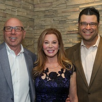 11 Dr. Franklin Rose, and Cindi Rose, from left, with Reuben Rolf at the Holly Rose Ribbon Shades of Roses kick off party July 2014