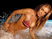 Ryan Lakich: Carmen Electra's boobs to be bronzed for breastaurant Hall of Fame: You're surprised?