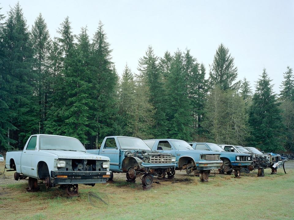 News_FotoFest 2010_Road to Nowhere_Eirik Johnson_Junked Blue Trucks, Forks, Washington_2007