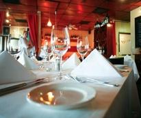 Chez Vatel Bistro table wine glass interior San Antonio restaurant