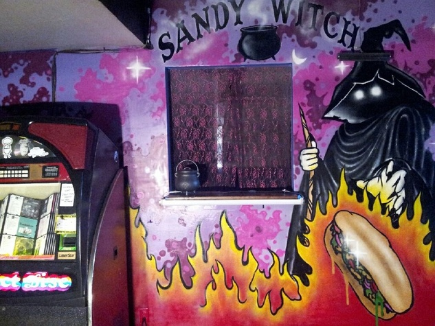 Sandy Witch Sandwich Company window Grand Prize bar