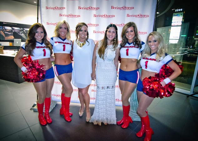 1 Amber Faye, left, and Claudia Ayala with Texans cheerleaders at the Bering Omega Toga Party July 2014