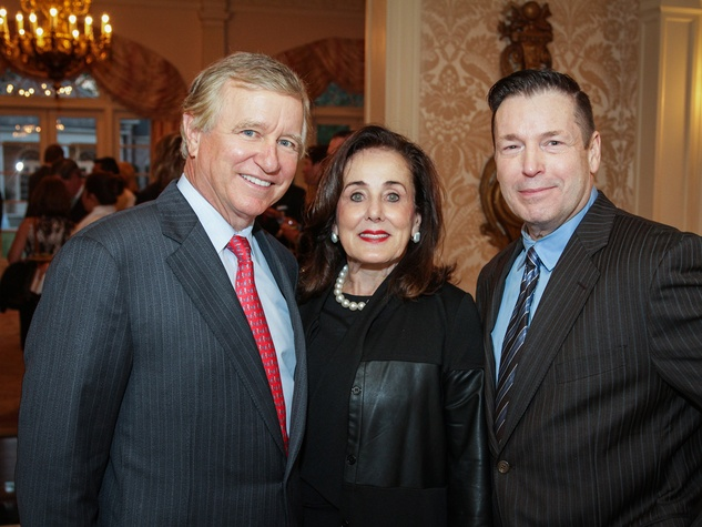 Jesse and Betty Tutor, from left, with Scott Evans at the Men of Distinction kick-off party February 2014