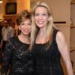 100 Vicki Rizo, left, and Mauri Oliver at the HeartGift photo exhibition May 2014
