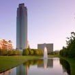 Williams Tower with fountain in bayou in front day