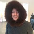 Cesar Galindo in fur hoodie at Sloan Hall