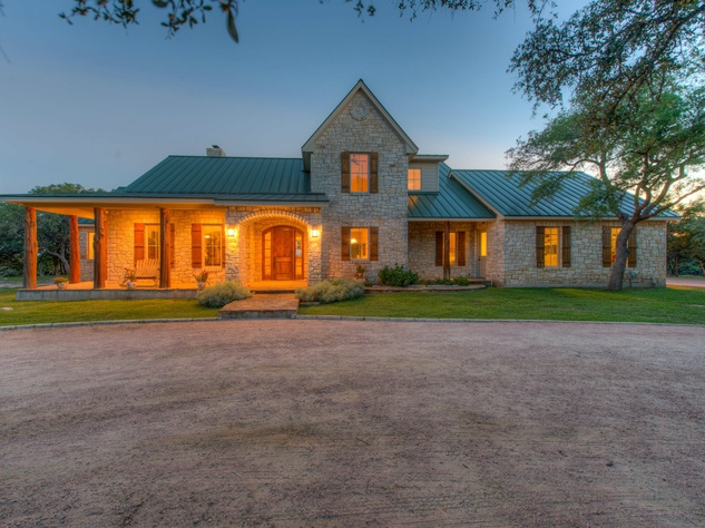exterior Red Adair ranch home at dusk