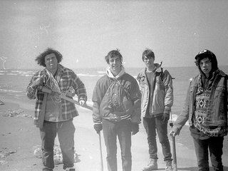 Chicago rock band Twin Peaks standing on a beach