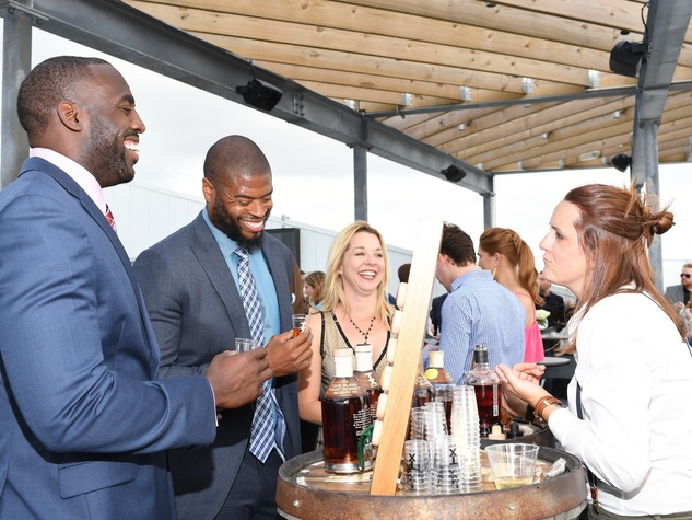 Whitney Mercilus, Wade Smith, Julie Baker Finck during TX Whiskey Sampling at Barbara Bush Foundation gala kickoff