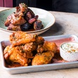 Pappas Delta Blues Smokehouse pork belly bites and chicken wings