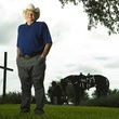 Bum Phillips with cross behind him