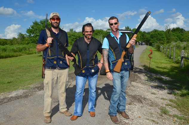 129 Chris Demillano, from left, Justin Smith and Thad Mills at the Backpack Buddies sport shooting event September 2014