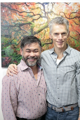 Sixto Wagan (left) poses with Matthew Dirst (right) at Art on the Avenue Preview Party