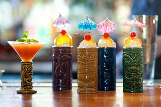 Cocktail shots in tiki glasses at Sunset Lounge