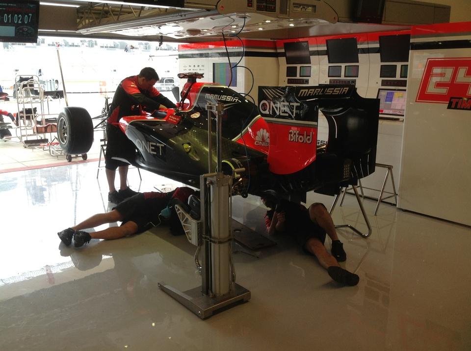 Austin Photo: Kevin_Marussia garage Formula 1_November 2012_glock car assembly