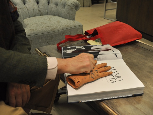 Mario Buatta interior designer October 2013 with fake hand