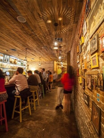 The Pastry War bar Houston interior with crowd