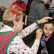 54 A patient gets her face painted at the holiday party at Santa visits Texas Children's Cancer Center December 2014