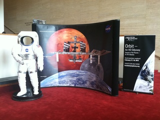 News_Houston Symphony_Orbit_lobby exhibits_spacesuit_space station