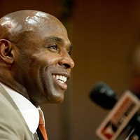 UT football coach Charlie Strong smiling at press conference