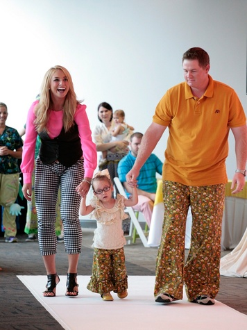 Bad Pants fashion show at Texas Children's August 2013 KHOU meteorologist Chita Johnson walks the runway with Madilynn Haefs and uncle Mark Case THIS.jpg