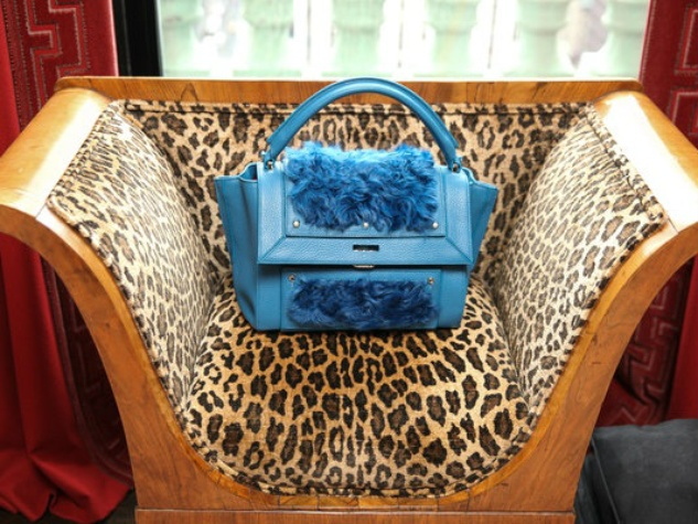 Dee Ocleppo handbag and leopard chair at Plaza apartment